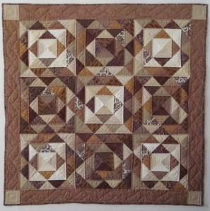 """Brown Triangles (A """"scrap"""" quilt made from purchased scraps.)"""