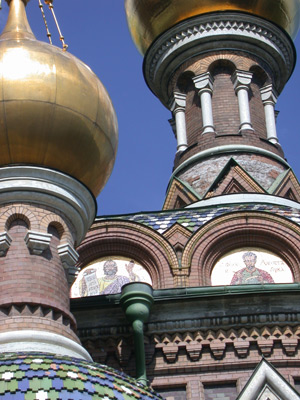 These spires are part of the Church of the Spilt Blood, which is Russian Orthodox..